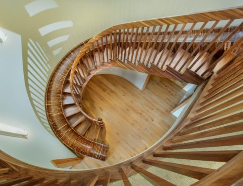 Featured by Homecrux: Top Tread Stairways Builds 33-ft-Long Black Walnut Staircase with Slide